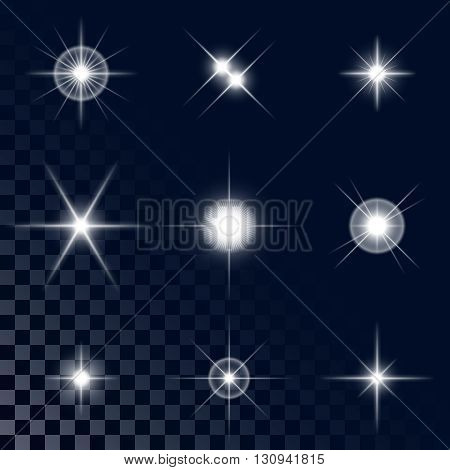 Set of the realistic sparkling white star fires and flashes on a transparent background a vector illustration