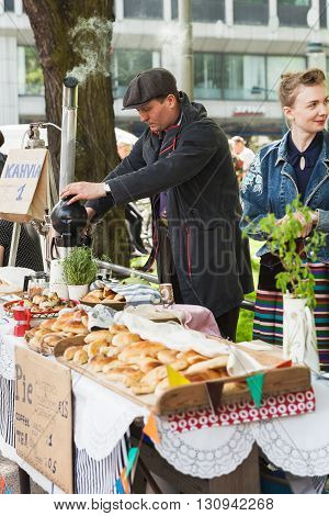 Young Positive Man With Samovar And Pies