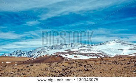 Snowy mountains. Severe mountains peaks covered by snow. Russia Siberia Altai mountains Chuya ridge.