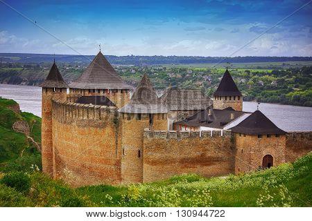 Khotyn castle on Dniester riverside. Dramatic blue sky. Ukraine