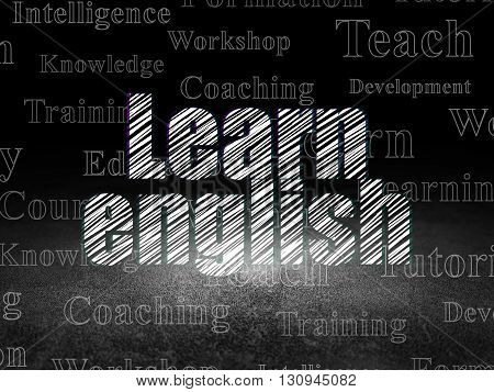 Learning concept: Glowing text Learn English in grunge dark room with Dirty Floor, black background with  Tag Cloud