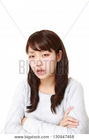 portrait of angry woman on white background
