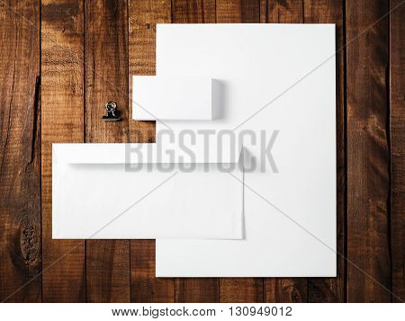 Blank stationery and corporate identity template on wooden table background. For design presentations and portfolios. Top view.
