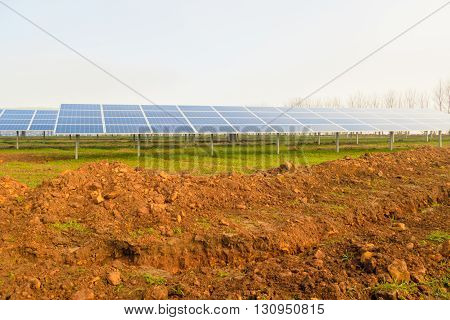 MANSFIELD WOODHOUSE ENGLAND - MARCH 13: Sunny but misty morning at a solar energy farm currently under construction. In Mansfield Woodhouse Nottinghamshire England. On 13th March 2016.