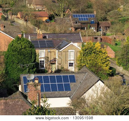 LUDLOW ENGLAND - FEBRUARY 21: Solar panels on rooftops of houses. In Ludlow England. On 21st February 2016.