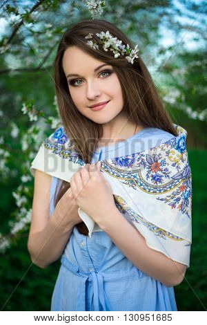 Happy Young Woman Posing In Blooming Summer Garden