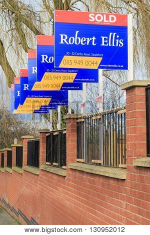 AWSWORTH ENGLAND - FEBRUARY 24: A row of 'Robert Ellis' estate agent 'sold' signs. In Awsworth Nottinghamshire England. On 24th February 2016.