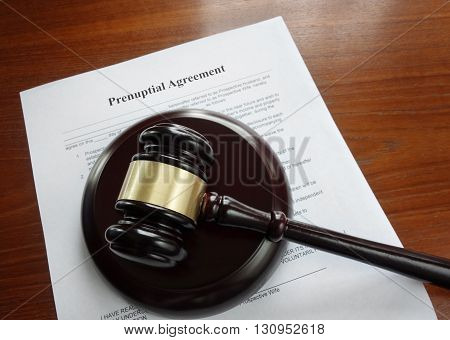 Prenup agreement on a desk with legal gavel