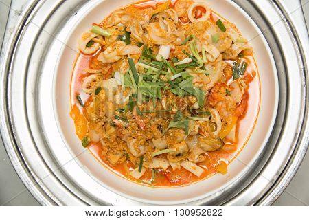 Stir - fried sea food with curry powder in dish