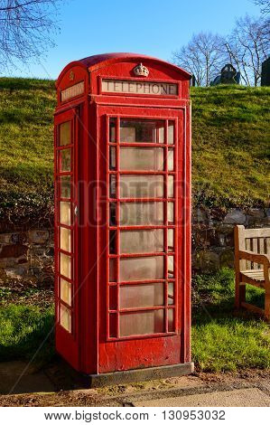 WYMESWOLD ENGLAND - JANUARY 15: A rural British red traditional telephone box. In Wymeswold England on 15th January 2016.