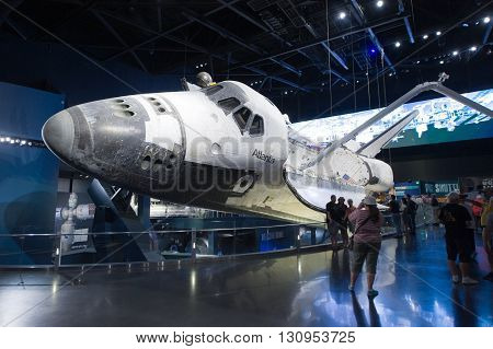 KENNEDY SPACE CENTER FLORIDA USA - APRIL 27 2016: Visitors looking at Space Shuttle Atlantis which is exhibited at the visitor complex of Kennedy Space Center