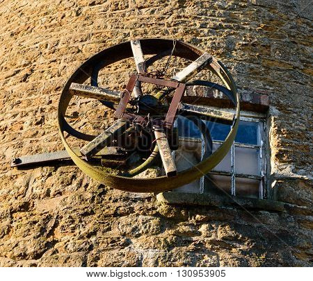 WYMONDHAM ENGLAND - JANUARY 15: A windmill winding wheel attached to the exterior of Wymondham windmill. In Wymondham England on 15th January 2016.