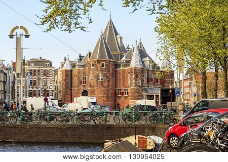 Amsterdam, Netherlands - May 4: It is Old Amsterdam's Gate in New Market Square May 4, 2013 in Amsterdam, Netherlands.