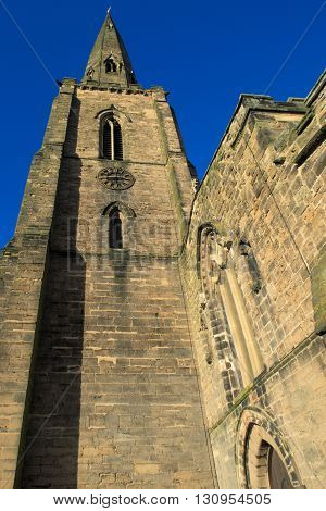 GEDLING ENGLAND - FEBRUARY 10: Low angle view of spire of All Hallows Church Of England church. In Gedling Nottinghamshire England. On 10th February 2016.