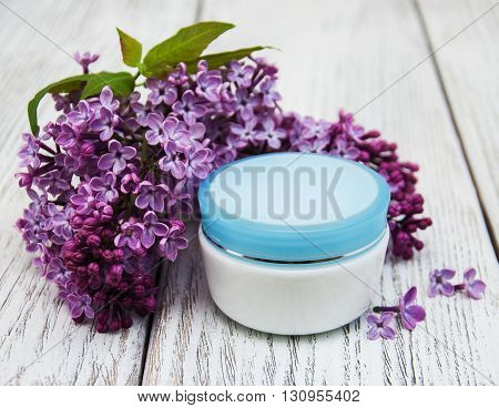 Moisturizing Cream And Lilac Flowers