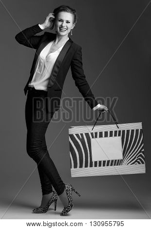 Happy Woman With Big Shopping Bag Against Grey Background