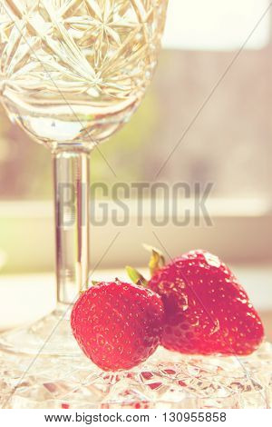 Crystal Glass with Wine and Strawberry in Light Vintage Style