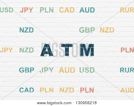 Banking concept: Painted blue text ATM on White Brick wall background with Currency