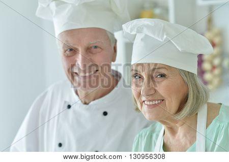 Portrait of a senior chefs couple at kitchen