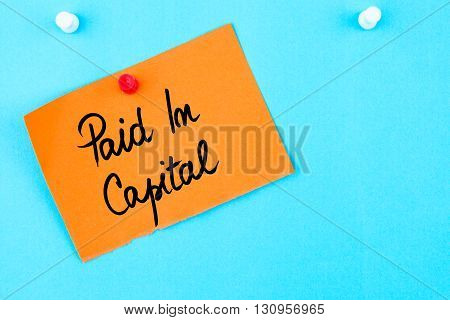 Paid In Capital Written On Orange Paper Note