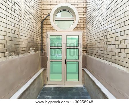 closed windows door with bricked walls around