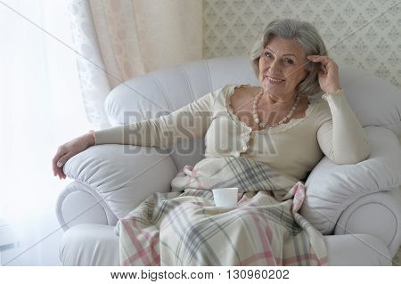 happy Senior woman resting at home with tea cup