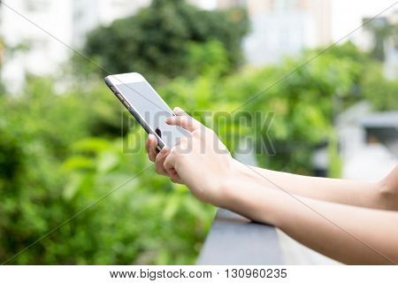Woman using mobile phone at park