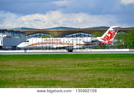 SAINT PETERSBURG RUSSIA - MAY 11 2016. Rusline Airline Canadair Regional Jet CRJ-100ER airplane -registration number VQ-BNE rides on the runway after landing in Pulkovo International airport