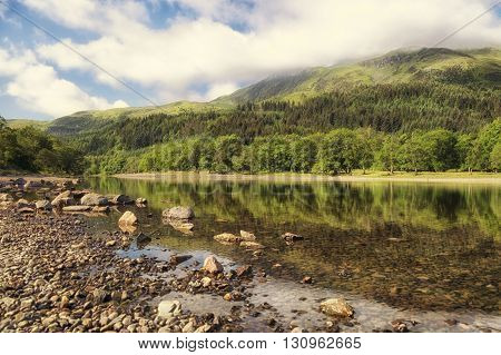 Landscape of tree reflections on Loch Lubnaig Scotland