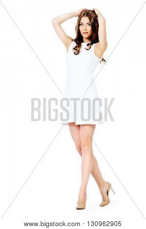 Full length portrait of a beautiful young woman in white dress smiling at camera. Isolated over white background. Beauty, fashion. Cosmetics.