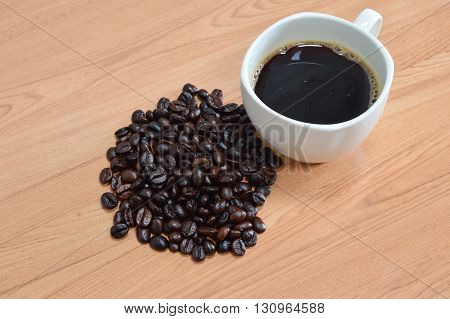 black coffee cup and seed on the table