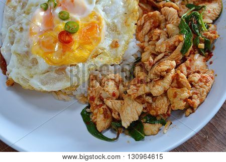spicy stir-fried chicken curry and egg on dish