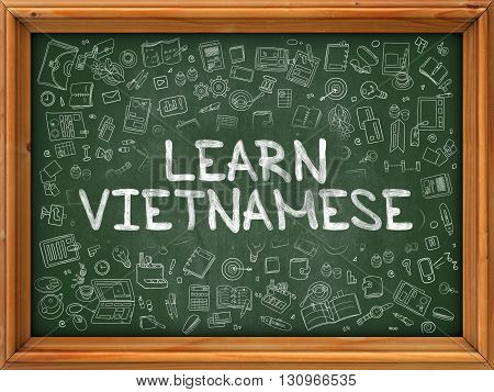 Learn Vietnamese - Hand Drawn on Green Chalkboard with Doodle Icons Around. Modern Illustration with Doodle Design Style.