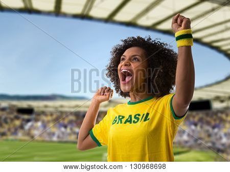 Brazilian young couple celebrating in the stadium