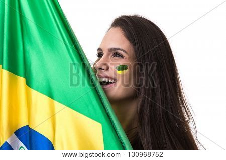 Young fan woman holding the flag of Brazil on white background