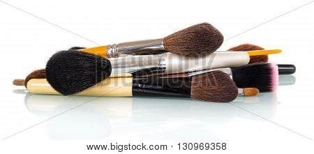 Cosmetic Makeup Brush lying in random order isolated on white background.