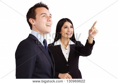 Female Coworker Pointing While Male Coworker Is Looking