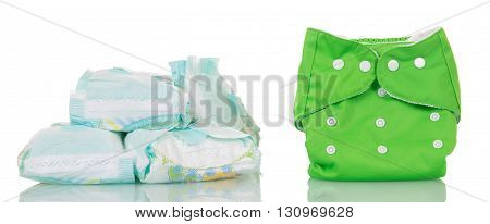 Modern disposable diapers and clean diaper isolated on white background.