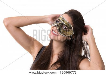 Beautiful young latina woman in carnival mask. Fashion photo