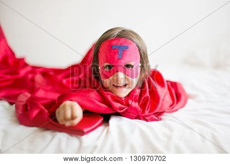 Sweet Little Preschool Boy, Playing Superhero At Home