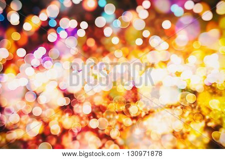 blurred and silver glittering shine bulbs lights background:blur of Christmas wallpaper decorations concept.holiday festival backdrop:sparkle circle lit celebrations display