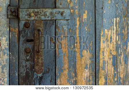 An Old Wooden Door With Cracked Paint. Background. Handle With Keyhole. The Old Iron.