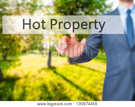 Hot Property - Businessman Hand Pressing Button On Touch Screen Interface.