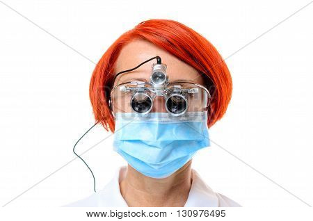 Red Headed Female Doctor Wearing Surgical Scope