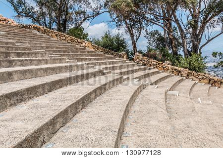 Rows of seating and stairs in the amphitheater of Mt. Helix Park in La Mesa, in San Diego, California.