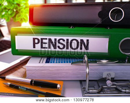 Pension - Green Office Folder on Background of Working Table with Stationery and Laptop. Pension Business Concept on Blurred Background. Pension Toned Image. 3D.