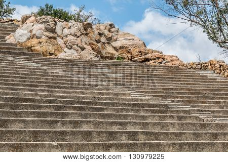 Amphitheater seating and steps with boulders at Mt. Helix Park in La Mesa, a city in San Diego, California.