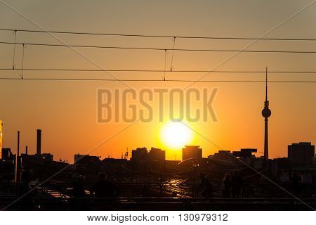 people berlin skyline and tv tower at sunset