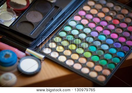 Bright colorful makeup palette, eyeshadow, close up