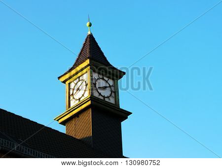 Tower clock in Rostock with sunset light